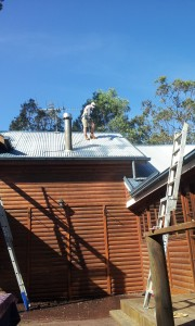 Jai Spraying Roof using harness safety system